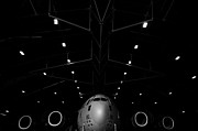Plane Nose Prints - A C-17 Globemaster Iii Sits In A Hangar Print by Stocktrek Images