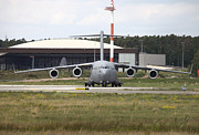 Taxiing Framed Prints - A C-17 Globemaster Taxiing At Ramstein Framed Print by Timm Ziegenthaler
