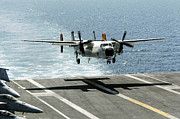 Aircraft Carrier Prints - A C-2a Greyhound Prepares To Land Print by Stocktrek Images