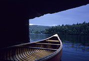 Boathouses Photos - A Canoe Sticks Out Of A Boathouse On An by Taylor S. Kennedy