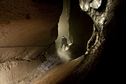 Jackson County Framed Prints - A Caver Moves Through A Wet Passage Framed Print by Stephen Alvarez
