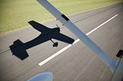 On The Runway Photos - A Cessna Light Aircraft Taking Off The Shadow Tells The Story by Richard Du Toit