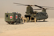 Afghanistan Photo Posters - A Ch-47 Chinook Helicopter Drops Poster by Andrew Chittock