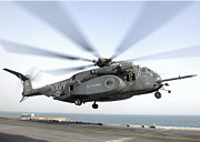 Helicopter Art - A Ch-53 Sea Stallion Helicopter Leaves by Stocktrek Images
