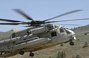 Landing Gear Posters - A Ch-53 Super Stallion Helicopter Lands Poster by Stocktrek Images
