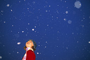 Snowflakes Posters - A Child Revels In Falling Snow Poster by John Burcham