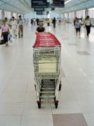 Consumption Prints - A Chinese Man Pushes Shopping Carts Print by Justin Guariglia