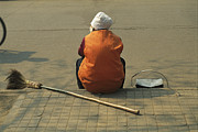 City Streets Framed Prints - A Chinese Person Rests On A Street Curb Framed Print by Todd Gipstein