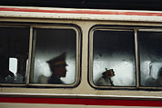 Tibet Framed Prints - A Chinese Pla Soldier Sits On A Bus Framed Print by Justin Guariglia