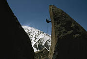 Buttermilk Photos - A Climber Rappels Off Grandma Boulder by Gordon Wiltsie