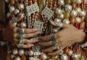 Coral Beads Posters - A Close-up Of A Brides Hands Displays Poster by James L. Stanfield