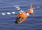 Search And Rescue Photos - A Coast Guard Hh-65a Dolphin Rescue by Stocktrek Images