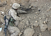 Revealing Posters - A Combat Engineer Carefully Scoops Dirt Poster by Stocktrek Images