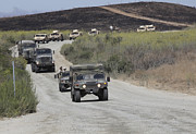 Hmmwv Posters - A Convoy Of Military Vehicles Poster by Stocktrek Images