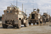 Military Base Framed Prints - A Convoy Of Mrap Vehicles Near Camp Framed Print by Stocktrek Images