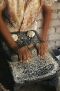 Madre Prints - A Cora Woman Grinds Corn For Tortillas Print by Maria Stenzel