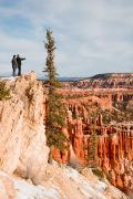 Southwest Us Framed Prints - A Couple Looks Out Over Bryce Canyon Framed Print by Taylor S. Kennedy