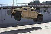 Carter Art - A Crane Lifts An M998 Humvee by Stocktrek Images