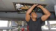 Mechanic Framed Prints - A Crew Chief Performs Work On An F-15 Framed Print by HIGH-G Productions