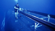 Submerge Photos - A Crewman Cranks Out The Dry Deck by Michael Wood
