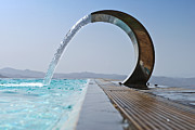 Art Product Prints - A Curved Stainless Steel Water Fountain Print by Corepics