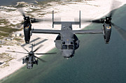 Rotor Blades Photo Prints - A Cv-22 Osprey And An Mh-53 Pave Low Print by Stocktrek Images