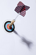 Archery Art - A Dart Stuck In The Bulls Eye Of A Miniature Archery Target by Larry Washburn