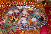 Oil Lamp Photos - A decorated Hindu prayer thaali with wax candles oil lamps by Ashish Agarwal
