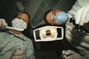 Photography Of Lamps Framed Prints - A Dentist And Dental Hygienist Prepare Framed Print by Joel Sartore