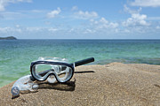 Diving Photos - A Diving Mask And Snorkel On A Rock Near The Sea by Caspar Benson