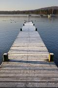 Diminishing Perspective Prints - A Dock In The Lake, Cumbria, England Print by John Short