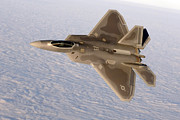 Stealth Prints - A F-22a Raptor Aggressively Banks Print by Stocktrek Images