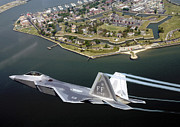 Stealth Prints - A Fa 22 Raptor Flies Over Fort Monroe Print by Stocktrek Images