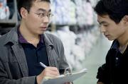 Peoples Republic Of China Photos - A Factory Employees Discuss Textile by Justin Guariglia