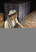 Production Photos - A Factory Worker Sorts Through Candy by Willard Culver