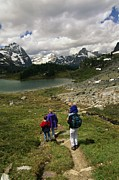 Mountains And Lake Prints - A Family Hikes Toward A Lake In Yoho Print by Michael Melford