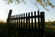 Property Released Photography Prints - A Fence Is Silhouetted Against The Sky Print by Joel Sartore