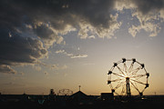 A Ferris Wheel Is Silhouetted Print by Stephen Alvarez