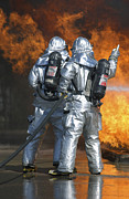 Courage Metal Prints - A Firefighter Fights A Fire Metal Print by Stocktrek Images