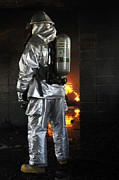 Courage Metal Prints - A Firefighter Waits For A Fire To Get Metal Print by Stocktrek Images