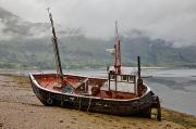 Water Vessels Art - A Fishing Boat Abandoned On The Shore by John Short