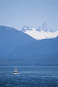 Snow Scenes Prints - A Fishing Boat Sails Near Devils Thumb Print by Rich Reid