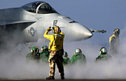 Signaling Posters - A Flight Deck Handler Directs An Fa-18e Poster by Stocktrek Images