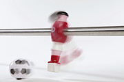 Mystery Tapestries Textiles Prints - A Foosball Figurine Kicking A Soccer Ball, Blurred Motion Print by Caspar Benson