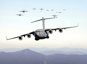 Large Group Of Objects Art - A Formation Of 17 C-17 Globemaster Iiis by Stocktrek Images