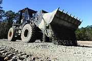 Dirt Roads Photos - A Front End Loader Raising A Road Bed by Stocktrek Images