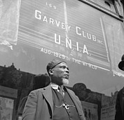 Civil Rights Posters - A Garveyite In Front Of The Garvey Club Poster by Everett