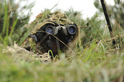 Field Glasses Prints - A German Bundeswehr Soldier Camouflages Print by Stocktrek Images
