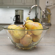 Furnishing Framed Prints - A Glass Fruit Bowl Full Of Pears Framed Print by Marlene Ford