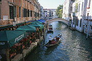 Vendors Posters - A Gondolier Passes A Restaurant Poster by Taylor S. Kennedy